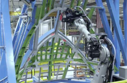Using robots to drill hard metals like titanium used in this frame for a composite aerostructure improves ergonomics and saves tooling costs. (Courtesy of Spirit AeroSystems)