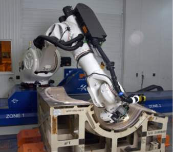 Improvements in robot capability allowed Spirit to implement a lower-cost and more flexible automation alternative for perforating the inner layer of composite nacelle structures. (Courtesy of Spirit AeroSystems)